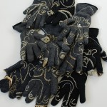 tzedakah (charity) gloves, installation: Size: 150cmx170cm Medium: wool, silver and gold thread, pearls.